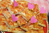 lots of pizza slices with heart-shaped flags at the little girl's party poster