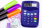 Writing word Anemia text in the office with surroundings such as marker pen writing on calculator. Business concept for Medical Diagnosis Iron deficiency aplastic white background with space poster