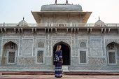 Woman travels in Itimad-ud-Daulah or Baby Taj in Agra India. Mughal mausoleum often described as a jewel box, sometimes called the Baby Taj, the tomb of I'timad-ud-Daulah. Wanderlust concept poster