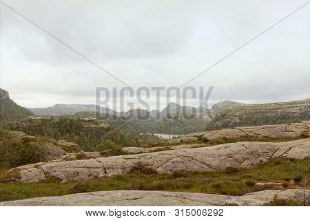 Road To The Cliff Preikestolen In Fjord Lysefjord - Norway - Nature And Travel Background. Vacation