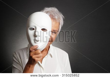 Happy Smiling Laughing Senior Woman Peeking From Behind Mask