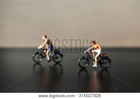 Miniature People : Travelers Riding Bicycle