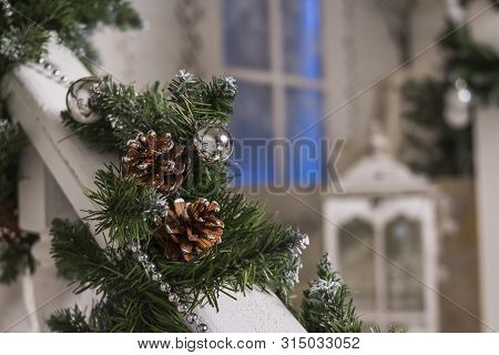 House Entrance Decorated For Holidays. Christmas Decoration. Garland Of Fir Tree Branches And Lights