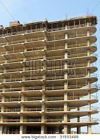 reinforced concrete frame building under construction at the sky