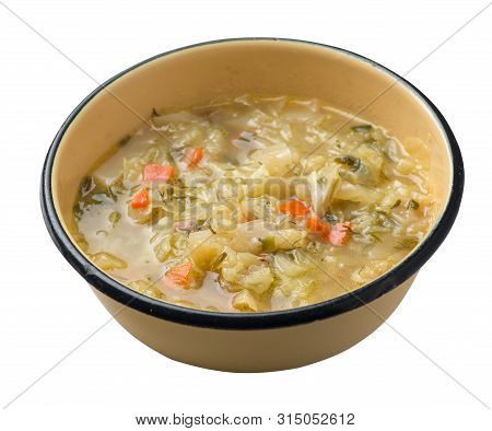 Cabbage Soup On A Yelow Black Plate Isolated On White Background. Vegetarian Soup Soup. Healthy Food