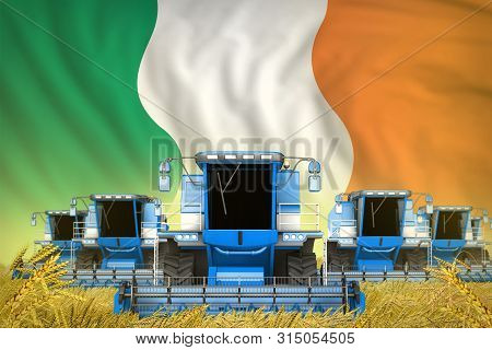 Industrial 3d Illustration Of Many Blue Farming Combine Harvesters On Rye Field With Ireland Flag Ba