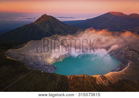 Aerivl View Of Kawah Ijen Volcano With Turquoise Sulfur Water Lake At Sunrise. Panoramic View At Eas