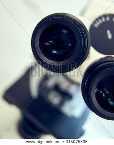 Microscope Eyepiece. Close Up Of Microscope Ocular In Laboratory.