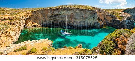 Malta. Summer Tropical Landscape With Picturesque Bay. Blue Lagoon With Yacht. Comino Island. Attrac