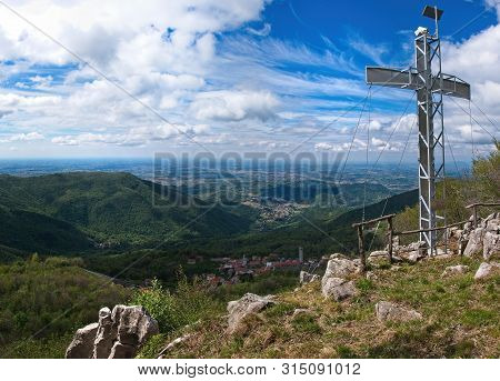 Mountain Peak With Cross And Dramatic Light