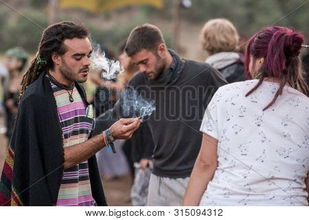 Riomalo De Abajo, Extremadura, Spain - July 15, 2018: A Young Man Shares A Joint With A Girl On The