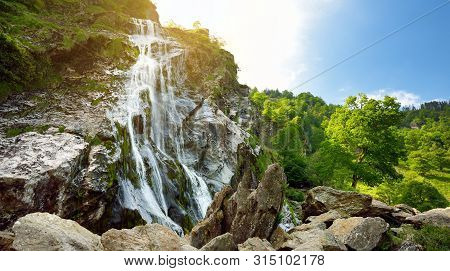 Majestic Water Cascade Of Powerscourt Waterfall, The Highest Waterfall In Ireland. Tourist Atraction