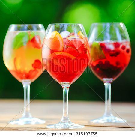 Summer Cocktail. Fruit Cocktail On Green Background. Citrus Fruits, Berries, Strawberries, Blueberri