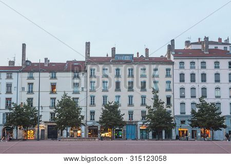 Lyon, France - July 17, 2019: Traditional French Housing Buildings With 19th Century Facades On Plac