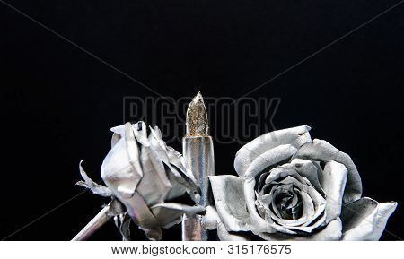 poster of glamour life. silver rose flower. grunge beauty fashion. Isolated on black. metallized antique decor. Makeup art. vintage retro design. wealth and richness. Glamour metallic lipstick
