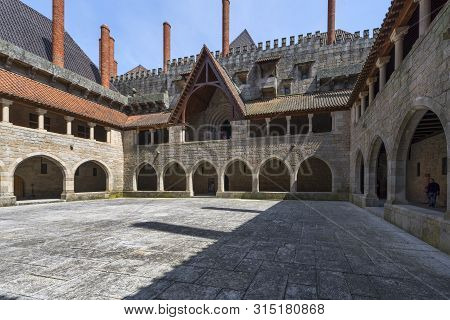 Guimaraes, Portugal  - April 2018: In The Courtyard Of The Palace Of The Dukes Of Braganza