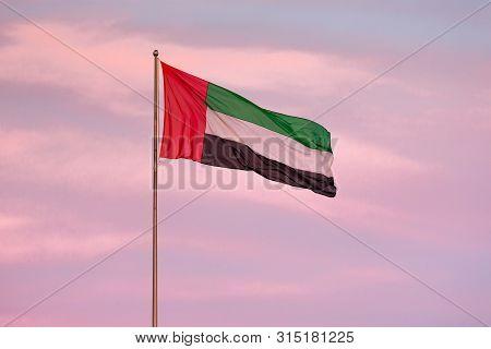 Uae Flag Waving In The Sunset Sky. Uae Flag Day.