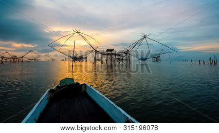Beautiful Nature Landscape Golden Light Of The Morning Sky At Sunrise And Native Fishing Tool And Pr
