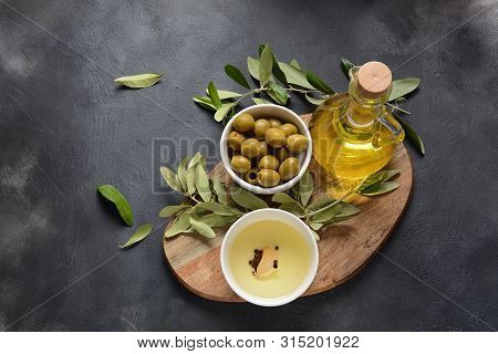 Extra Virgin Olive Oil , Olive Branch And Olives On A Dark Background