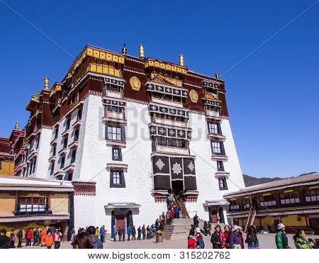 Tibet, Lhasa - April, 21, 2012 - Main Entrance To Potala Palace: Visitors Waiting In Line In The Cou