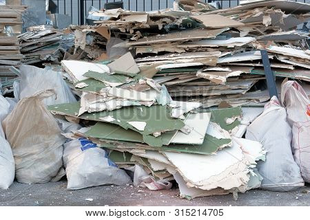 Construction Garbage Is Piled Up At Site After Building Repair. Trash Heap.