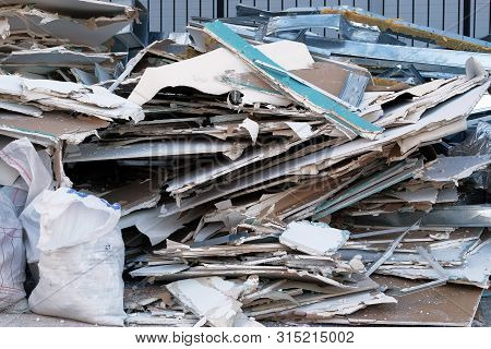 Building Demolition. Construction Garbage Is Piled Up At Site After Building Repair.