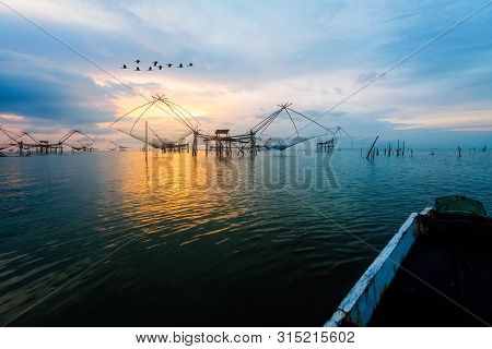 Beautiful Nature Landscape Golden Light Of The Morning Sky At Sunrise With Flock Of Birds Are Flying