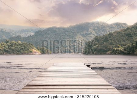 Wood Bridge On The Sea Which Has Walk Way For Travel Tourism With Tropical Forest Island And Sunshin