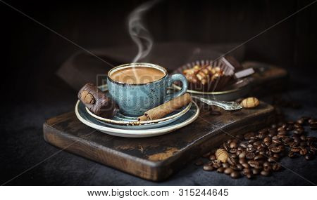 Aroma, Background, Bean ,beans ,drink, Black, Blue Cup Of Coffee, And Coffee Beans, On An Old Board,