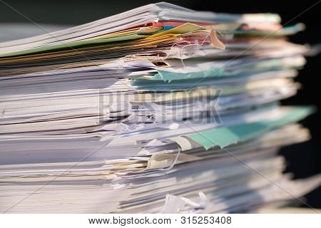 Piled Heap High Documents Folders, Stack Business Paper On Desk Messy Or Paperwork In Office. Old Do