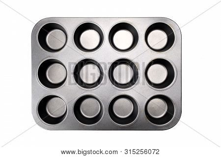 Muffin Tray Isolated On White Background With Selection Path.