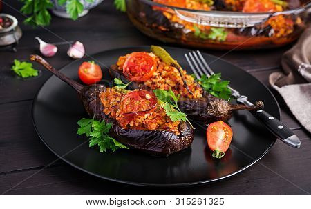 Karniyarik - Turkish Traditional Aubergine Eggplant Meal. Stuffed Eggplants With Ground Beef And Veg
