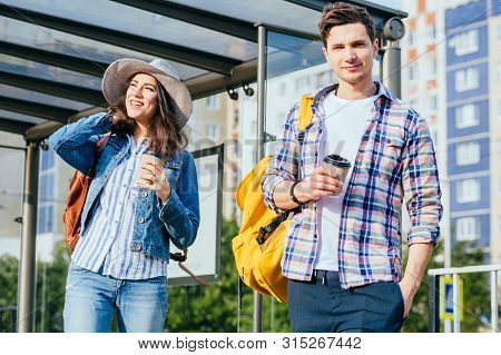 Guy At Bus Stop Looking At Camera, Excited Girl Standing Next To Him, Waiting For Tram, Love At Firs