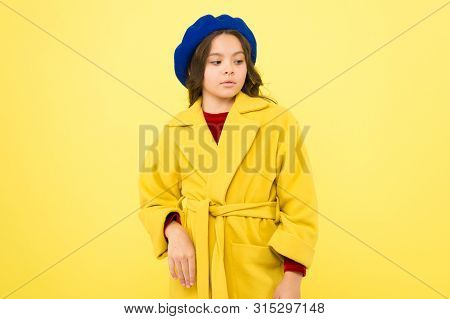 Everyone Needs Coat This Winter. Girl Fashionable Cute Model Wear Yellow Wool Coat. Pensive Child In