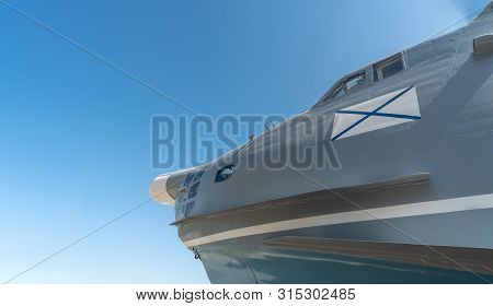Nose of military airplane with ensign of Russian Navy. Copy space. Blue sky russian background poster