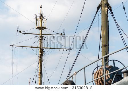 Ship Mast Of Frigate, Longboat Or Navy Battleship. Metal Mast Pole. Ship Awaits Captain At Docks. Lo
