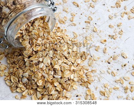 Oat Groats Or Oat Spike In Wooden Plate On Homespun Tablecloth, Copy Space, Top View, Selective Focu