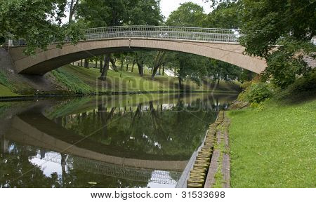 Bridge In City Park In Centre Of Riga
