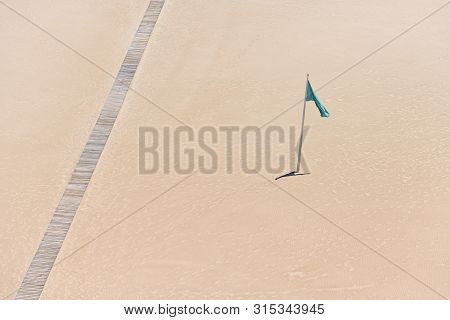 Beach And Green Flag In Cullera, Spain, Stock Picture
