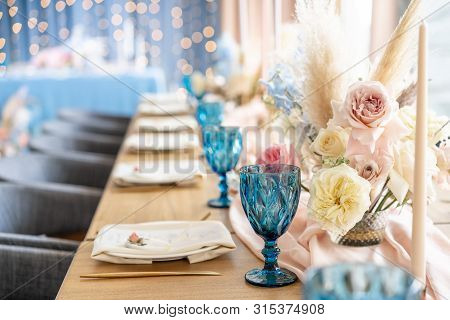 Luxury Dinner Banquet In The Restaurant. Beautiful And Exquisite Decoration Of The Wedding Celebrati