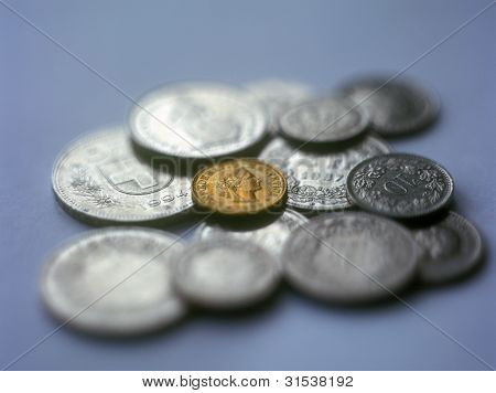 Swiss Coins On The Blue Background.