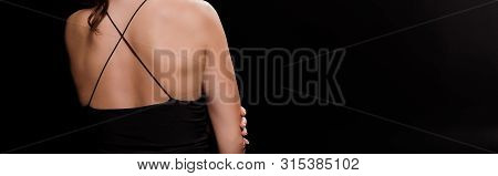 Panoramic Shot Of Young Woman In Dress Isolated On Black