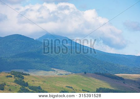 Mountain Peak In The Clouds. Lovely Early Autumn Nature Scenery In Mountains