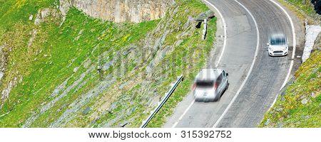 Transfagarasan Mountain Road. Wonderful Travel Destination Of Romania. Lovely Transportation Backgro