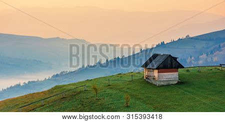 Amazing Beautiful Rural Area At Dawn. Morning In The Carpathian Mountains. Fog In The Distant Valley