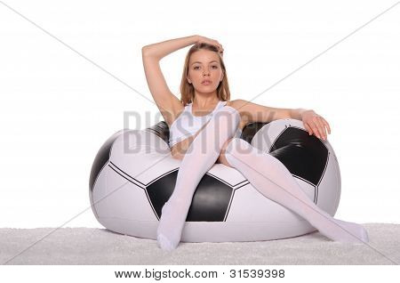 Beautiful Football And Soccer Fans In An Armchair