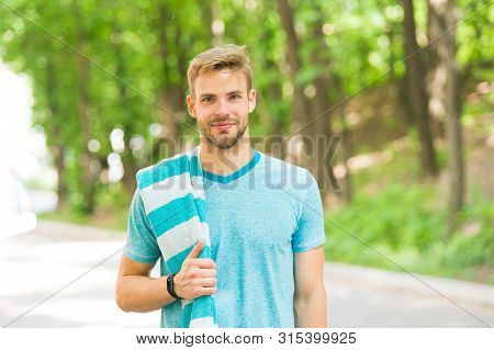 Healthy And Active. Blond Man. Handsome Man Wearing Casual Tshirt With Towel On Natural Landscape. M