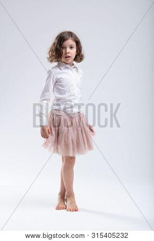 Little Girl In Pink Ballet Tutu Or Filmy Skirt