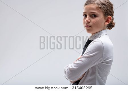 Serious Young Girl Looking Intently At The Camera