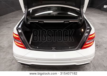 Novosibirsk, Russia - July 12, 2019:   White Mercedes-benz C-class, Close-up Of The Open Trunk, Fron